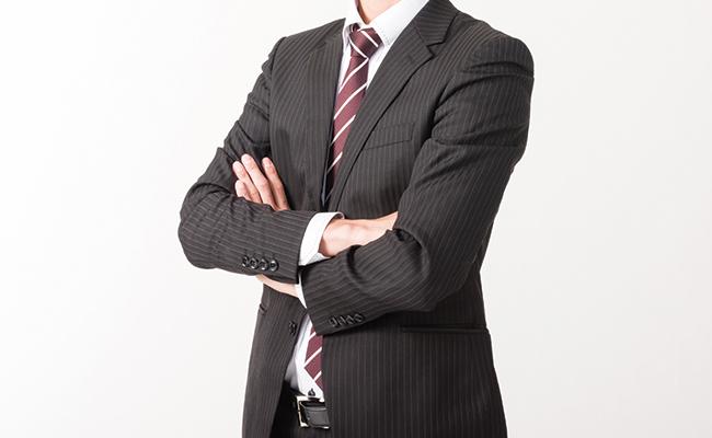 自信を持つ誹謗中傷被害対策会社のビジネスマン